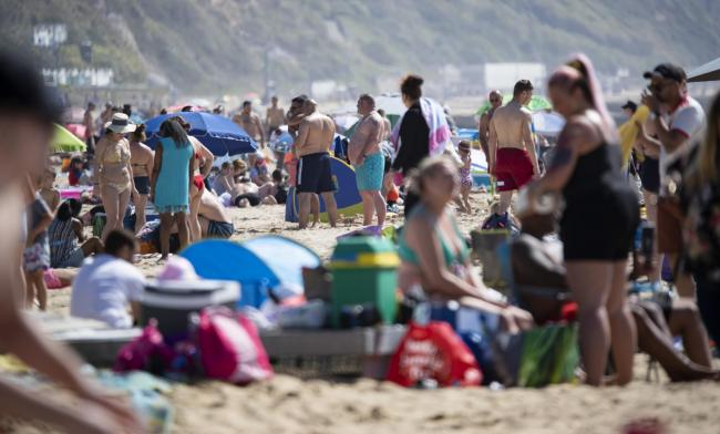 A hot sunny Saturday draws crowds to Bournemouth beach. Pic: CorinMesser/BNPS