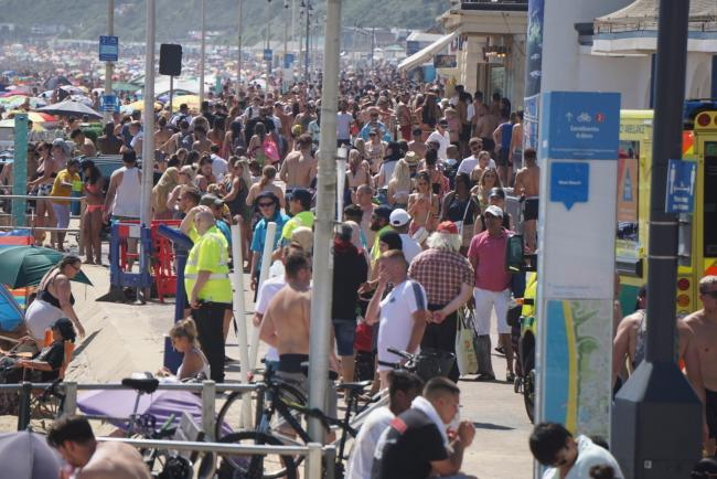 Thousands of people flock to Bournemouth beach as temperatures hit 28 degrees