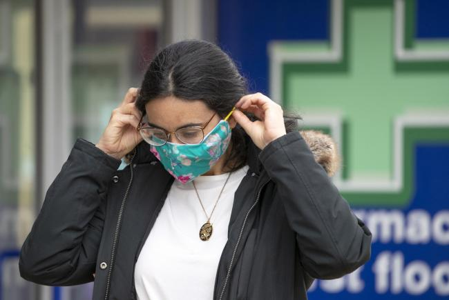 A shopper wears a protective face mask in Edinburgh's Princes Street. PA Photo. Picture date: Thursday July 2, 2020. It was announced today that face coverings will be mandatory in shops in Scotland from July 10. See PA story HEALTH Coronavirus. Photo
