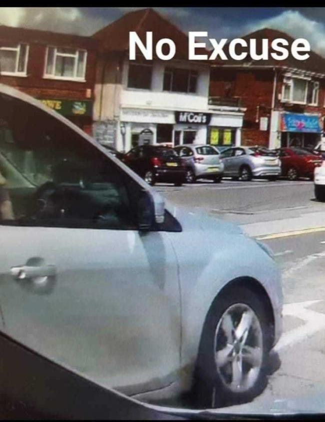 Driver of Ford Focus caught speeding and sticking middle finger up at police. Pic: Dorset Police No Excuse