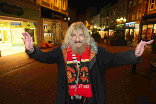 STREET LIFE: Gordon Roberts (affectionately known locally as Gordon the Tramp) pictured last night very much alive in Old Christchurch Road, Bournemouth, minutes after rumours of his death appeared online
