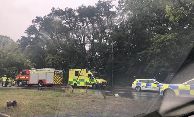 Bournemouth Echo: Emergency services at the scene at Parley Cross. Picture: Kerry Brown