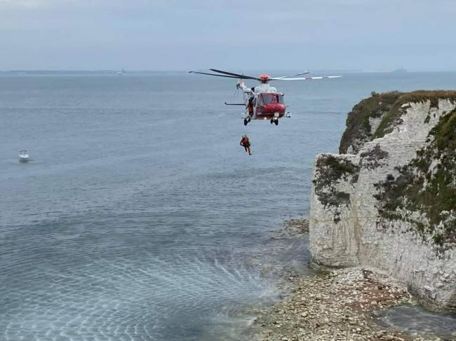 The Coastguard helicopter at the scene. Picture: Swanage Fire Station
