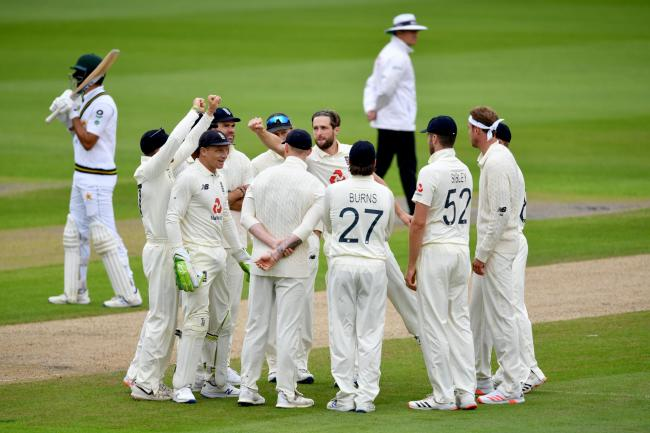 England celebrate a Chris Woakes wicket