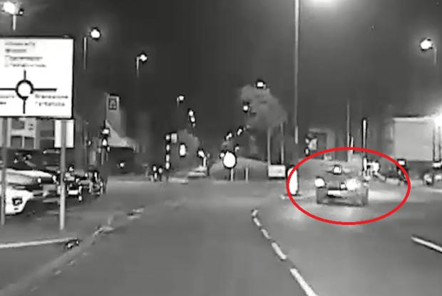 Bournemouth Echo: The defendant pictured driving his car the wrong way round Wallisdown roundabout. Footage: Dorset Police