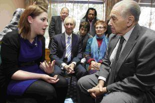 SHARING MEMORIES: Holocaust survivor Walter Kammerling chats to Bournemouth School for Girls sixth form student Philippa Hathaway, 18, about her trip to Auschwitz