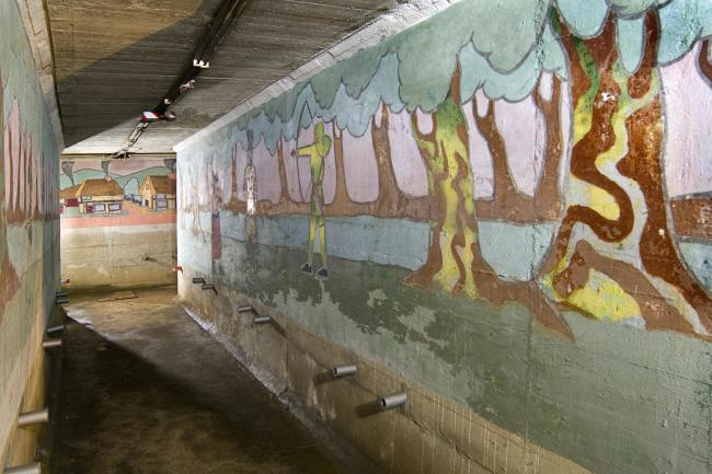 A boys' air raid shelter featuring a set of colourful murals depicting scenes from various literary tales at St John's Primary School in Redhill, Surrey