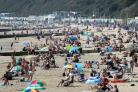 PICTURES: Beachgoers enjoy September sun at the seaside in Bournemouth