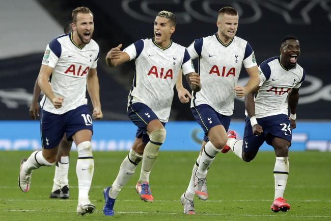 Eric Dier, centre right, celebrates with Tottenham