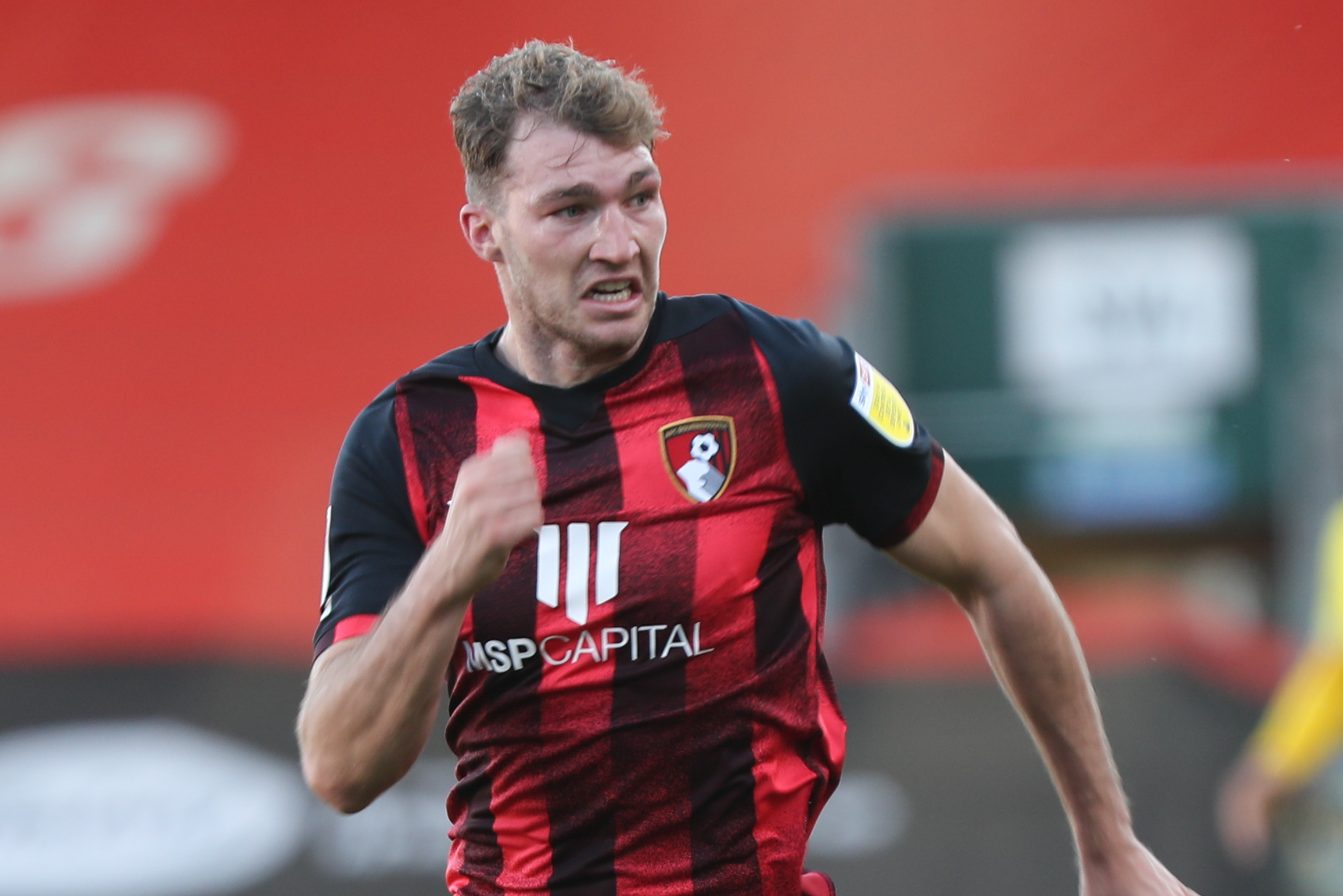 Tindall believes flying wing-back Stacey is growing in confidence at Cherries