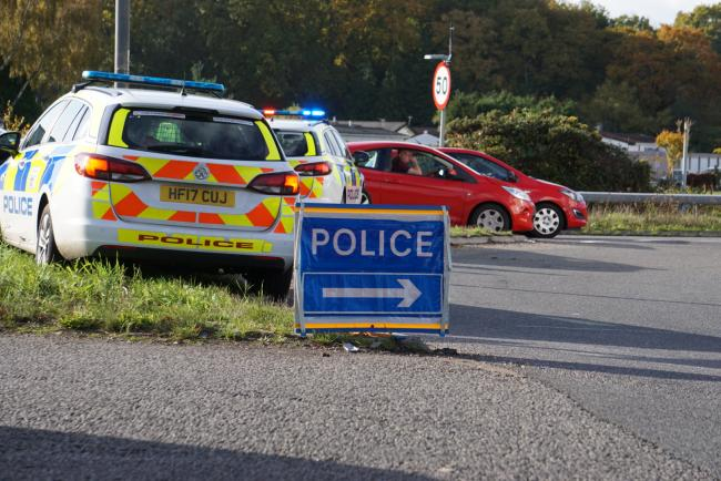 Police at the crash on the A31 at Palmersford Roundabout