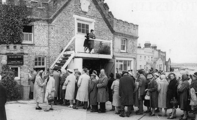 Visitors queue to post a letter from the old post office on May 16 1963, the day Brownsea Island is opened to the public. More than 1,000 people attend the opening ceremony, which is carried out by Lady Baden-Powell.