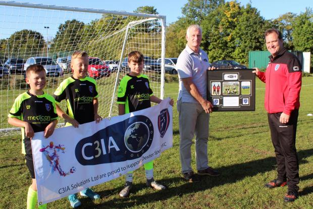 Matt Horan (left) receives a presentation plaque from Greg Partridge, manager of Dexter's Under 11 Lions, with three of the players looking on