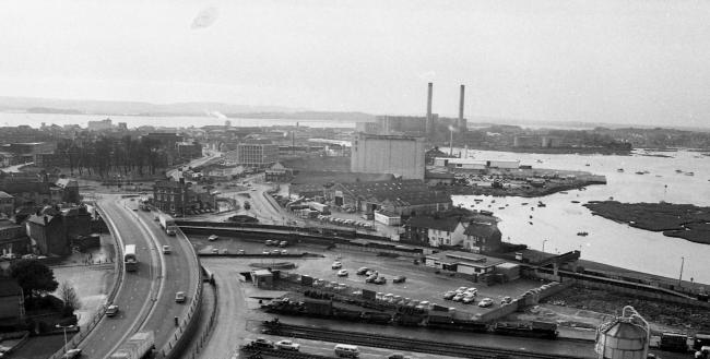 This fascinating view of Poole, taken from the Barclays building while it was under construction circa 1977, gives a view across the town of Hamworthy and beyond. The many changes that have occurred makes it easier to list the buildings that are still her