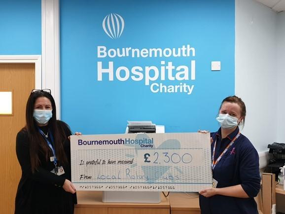 Fundraising Manager Karen Smith, left, and Consultant Therapist in Stroke and NHR clinical lecturer Louise Johnson reciove a cheque from The Rotary Clubs of Christchurch, Bournemouth Eastcliff, Parkstone, and Bournemouth North to Bournemouth Hospital Char