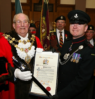 CEREMONY: Poole's mayor Charles Meachin presents Deputy Colonel Commandant The Rifles Brigadier Richard Toomey CBE with a scroll and sword to mark the freedom of the Borough of Poole