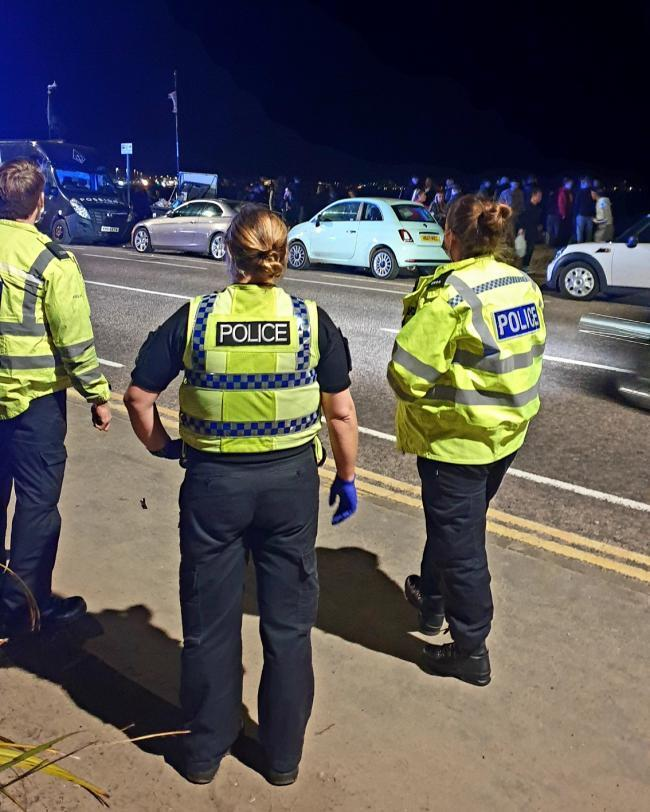 Police have appealed for witnesses with mobile phone evidence to come forward after a fight involving 150 people at Sandbanks