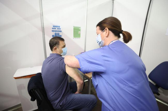 A man receives a Covid-19 vaccination