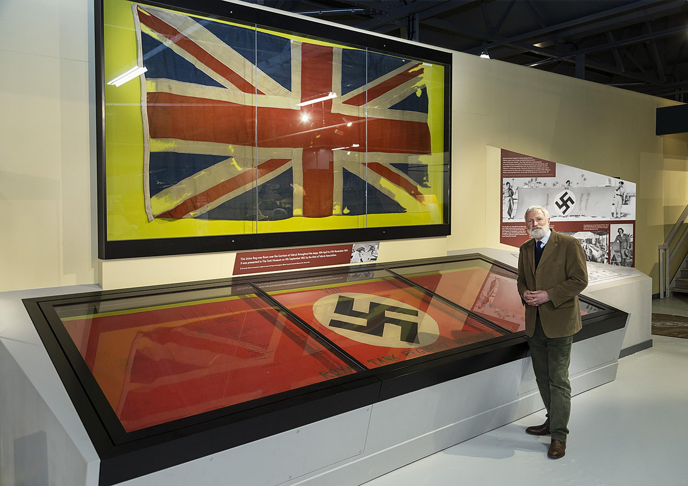 Historic World War II Union Jack and swastika in exhibition