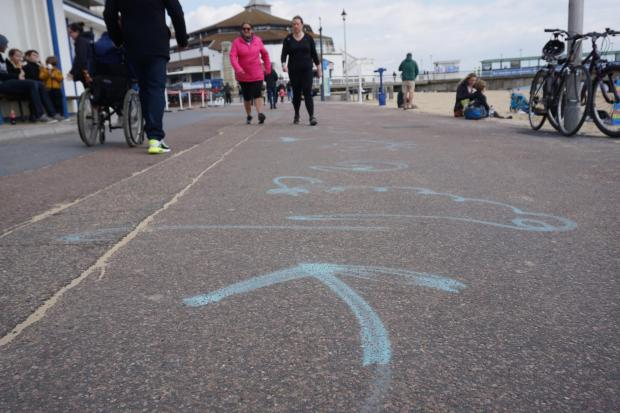 Bournemouth Echo: The markings left behind from Pavilion Dance South West's Invisible Dances along Bournemouth promenade have caused a lot of controversy, with many people mistaking it for graffiti