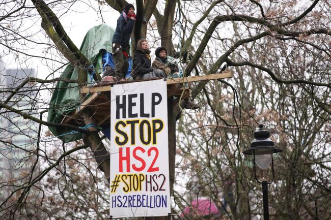 HS2 Rebellion protesters in a tree, part of an encampment in Euston Square Gardens in central London, where the protesters have built a 100ft tunnel network, which they are ready to occupy, after claiming the garden is at risk from the HS2 line