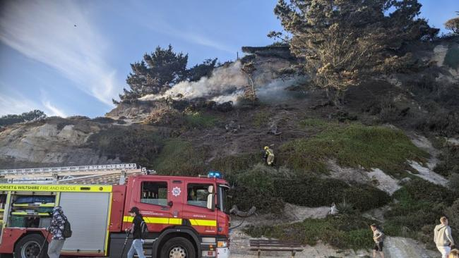 Firefighters tackle blaze on the cliff at Branksome Dene beach. Picture: Kieran Thompson