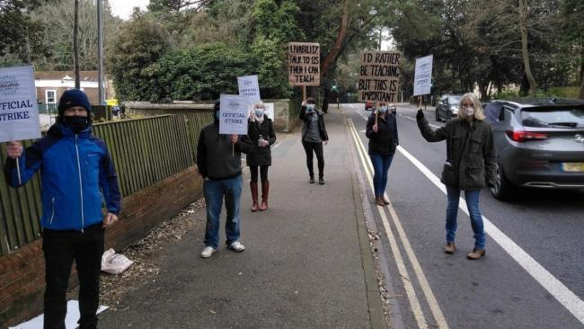 Teachers take strike action at Victoria Education Centre