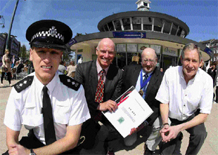 CRACKDOWN: Inspector Wayne Nock, Mark Smith, Nigel Hedges and Cllr David Smith in Bournemouth Square with the new legislation document preventing illegal street trading in the town