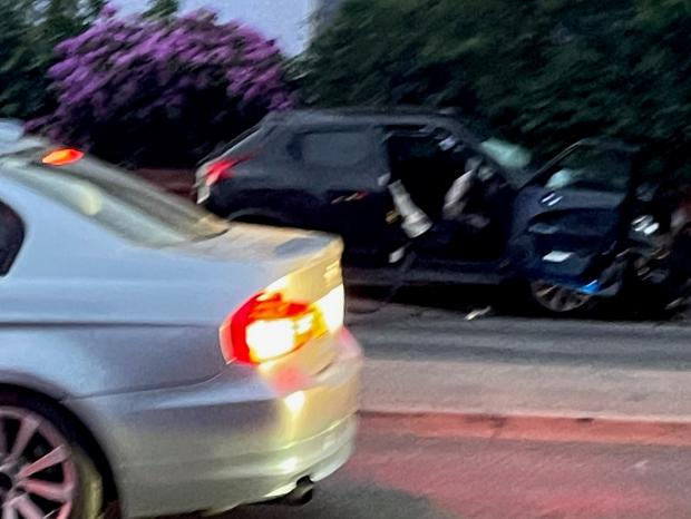 Bournemouth Echo: The black car involved in the crash.  Photo: Jay Saunders