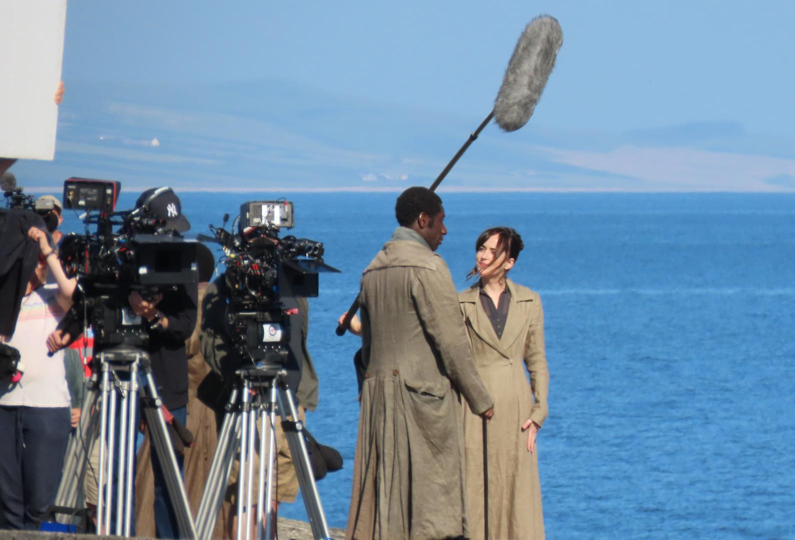 Hollywood star steps out in period costume to film by the sea in Dorset