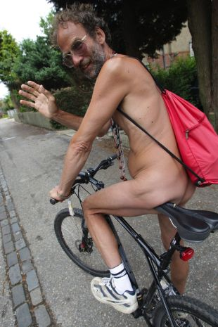 QUITE A CHEEK: Naked bike rider Richard Collins, who was arrested by police