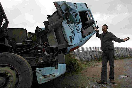 Vandals smash lorries with JCB