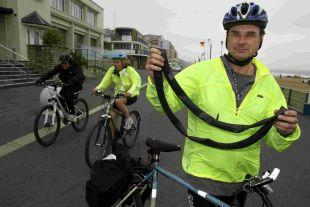 CYCLE OF DESPAIR: Cyclist Michael Atkinson with one of the punctured inner tubes which he says were caused by metal tacks left on Bournemouth prom