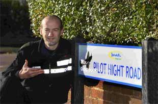 TRIBUTE: PC Rob Hammond and one of the new road signs at Pilot Hight Road, West Howe, which now has the image of a Spitfire on it, to honour Battle of Britain pilot Cecil Hight, killed in action over Bournemouth