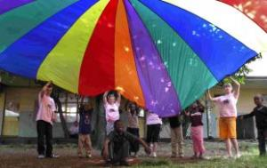 FUN AND GAMES: Parachute games featured regularly during the activity week the students ran for special needs children