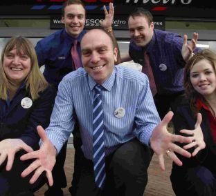 Tesco Metro manager Steve Thomson with members of his team