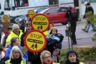 Families march in bid to save lollipop patrols