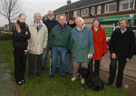 Residents objecting to plans for a phone mast with Cllr Basil Ratcliffe, centre, and Cllr Malcolm Davies, right.