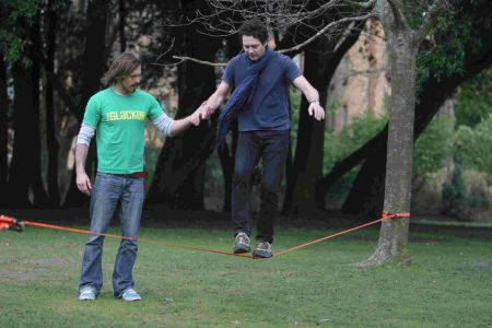 The Echo's Patrick Gough tries out slacklining under the guidance of Russ Holbert from Maverick Slacklines
