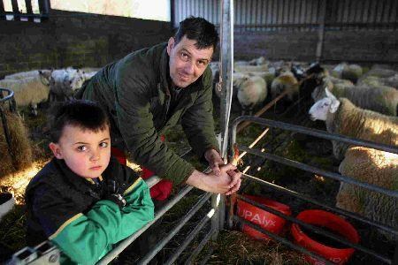 John Wood, from Merley Hall Farm, and his son Joseph, 7