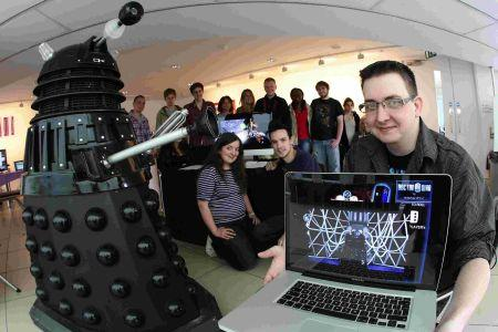 Digital Media student Doug Inman, 28, with his lifesize Dalek which features in a video game he has produced. Pictured with him are other Bournemouth and Poole College students displaying their final projects