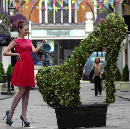 Monique Cockerill poses with the giant Lady Gaga shoe created by New Forest firm Agrumi and installed in London's West End