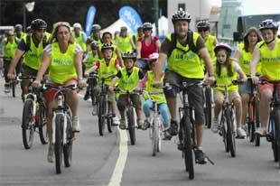 Bournemouth Echo: ON YER BIKE: Cyclists set off from Meyrick Park on the Bournemouth Sky Ride. Picture: Richard Crease