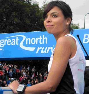 "EMOTIONAL TRIBUTE: Dr Emma Egging watches as the Red Arrows fly over the start line of the Great North Run, in the ""missing man"" formation, in honour of her late husband Flt Lt Jon Egging"