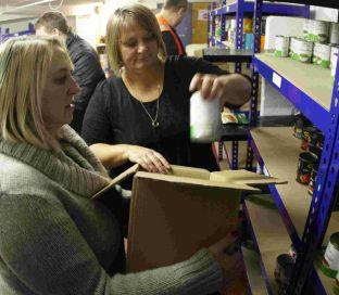 SUPPLIES NEEDED: Debbie Bramley, right, and Vicki Lent repare a food parcel