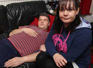 RECOVERING: Hit-and-run victim Justin Graham, who was knocked off his bike at the Wallisdown roundabout and has broken bones in his back, with wife Rayna