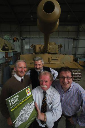 TANKS A LOT:  Jonathan Falconer, right, of Haynes with, front, historian David Fletcher, workshop manager Mike Hayton, left, and curator David Willey at Bovington Tank Museum