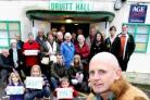 PETITION: Chairman of the Friends of Druitt Hall committee, David O'Sullivan is joined by other members of all ages as they fight to save the hall from demolition