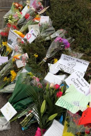 TRIBUTES: Flowers and messages left at Portchester School
