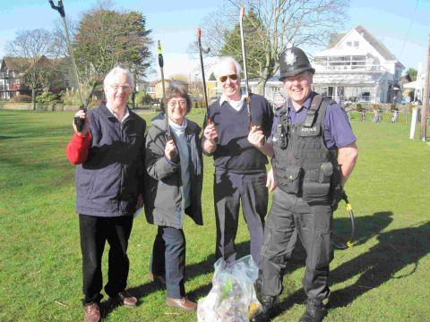 CLEANING UP: Cllrs Nick Geary, Gillian Geary, Peter Hall and PC Dave Williams